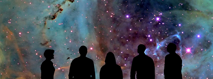 People viewing the cosmos inside a planetarium